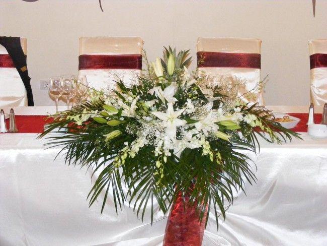 Pret Aranjament de prezidiu din Crini si Orhidee Dendrobium. Categoria Aranjamente masa, Prezidiu, Modele, Preturi, Oferte.