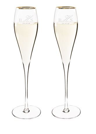 "The Personalized Rimmed Champagne Flutes feature an elegant shape and a brilliant silver or gold rim for a luxurious look. These custom engraved glasses are perfect for a wedding or special occasion. Bringing contemporary romance to your wedding, this modern stemware will be raised for a toast for years to come! Features and Facts:  Sold in a set of two.  Measures: 3"" L x 3"" W x 13.5"" H; Holds 7 oz.  Note: Minor bubbles and swirls are inherent to hand-blown glass.  Care Instructions:"