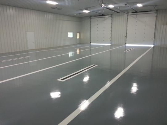 Blastrac floor GP primer, GP self leveler, HPU topcoat with high build striping.....
