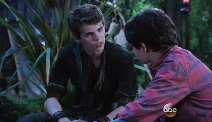 Robbie Kay as Peter Pan and Jared Gilmore as Henry Mills ...