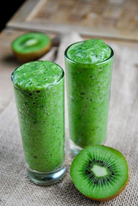 Healthy, refreshing green kiwi smoothie with spinach, cucumber, and banana! Instructions:  200 g cucumber 1 huge banana 4 ripe kiwis 2-3 handfuls of fresh spinach  Instructions:  First, cut the kiwis, banana and cucumber into small pieces. Using a blender, blend it all together with the spinach until smooth. Serve it right away.  Benefits:  Protection against age-related macular degeneration Kiwi has more Vitamin C Improves good sleep