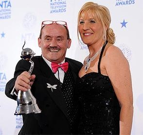 Brendan O'Carroll and his wife Jennifer Gibney with the Best Situation Comedy Award for Mrs Brown's Boys