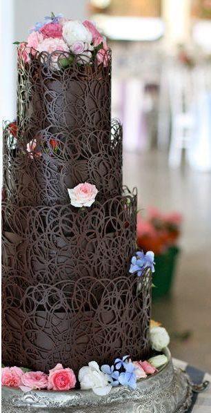 Absolutely wonderful chocolate covered cake. Beautiful wedding cake.