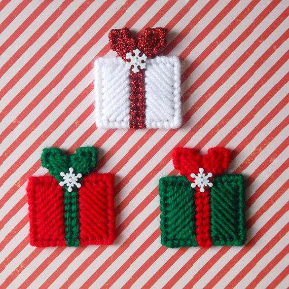 Keep your fridge, locker or magnetic white board festive this season with cute and colorful Christmas magnets!  This listing is for 3 Christmas gift magnets. They are sewn in cherry red, paddy green, white and metallic red yarns. The gifts are each topped with a tiny snowflake button. Each Christmas gift magnet measures approximately 1 3/4 inches wide and 2 inches high. Thank you for checking out my Etsy shop