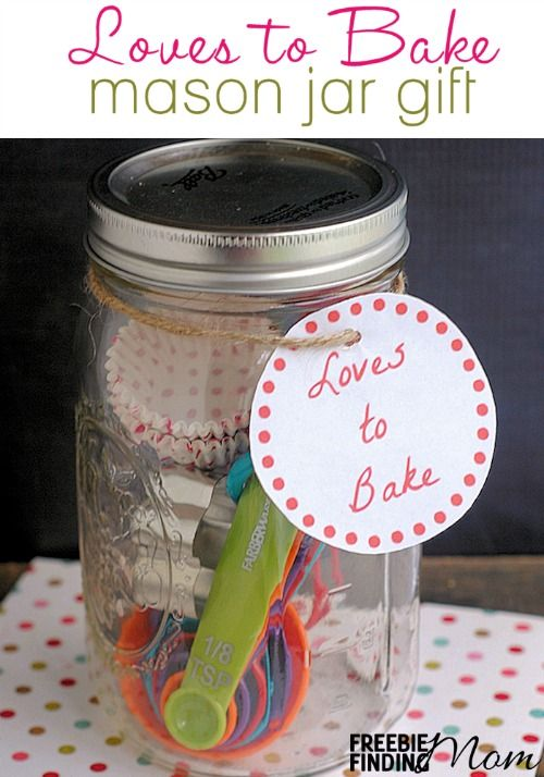 Loves to Bake Mason Jar Gift - Need an easy yet thoughtful DIY gift idea for someone who loves to bake? Gift them a Mason jar loaded with baking essentials like measuring spoons, mini baking cups, mini cookie cutters, a mini spatula and more so they can get started whipping up their next fabulous creation.
