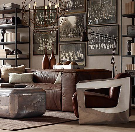 leather couch / wall of vintage photos / oversized light