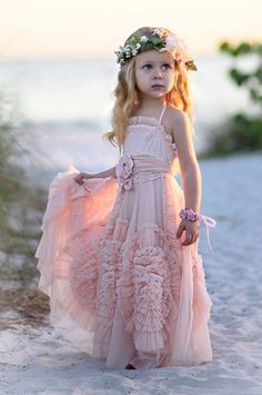 These unbelievably cute flower girl dresses will melt your heart. Perfect for that special little girl helping make your destination beach wedding even more stunning!