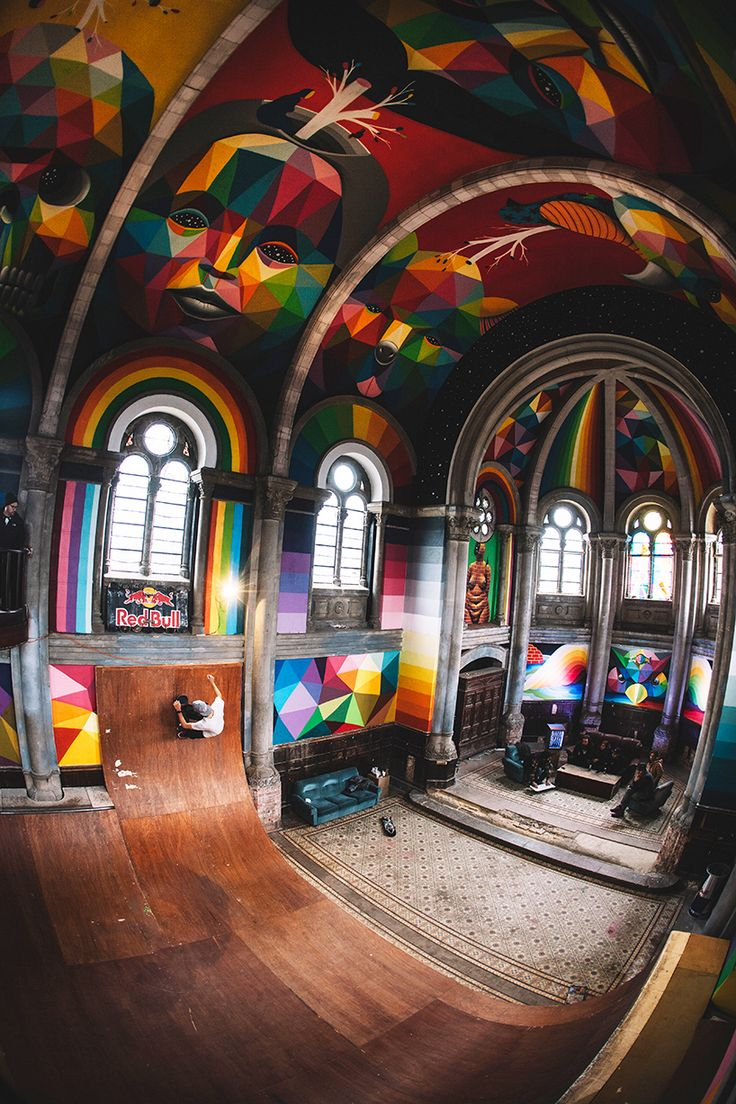 okuda san miguel has completed a mural within an indoor skate park hidden within a spanish church.