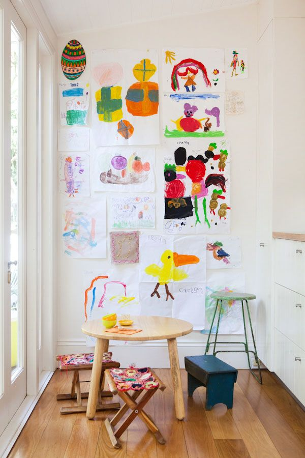 Kids art and craft nook. How sweet are the little stools? Those big built in drawers look like an easy way to tidy up! Great use of a small space!