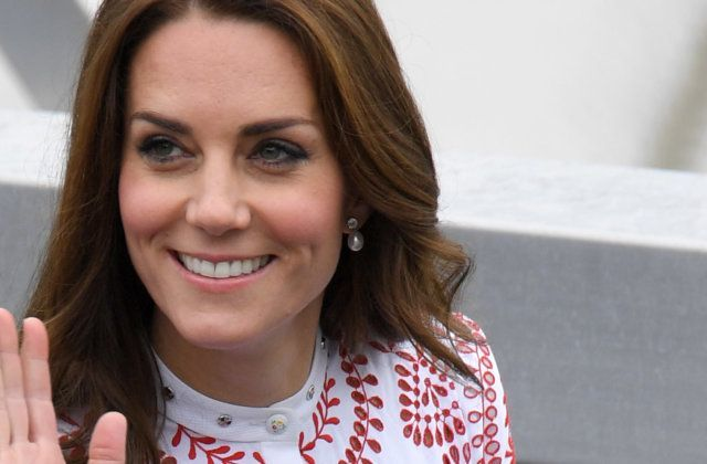 Duchess Kate pulls off  bright red frock with bizarre pattern
