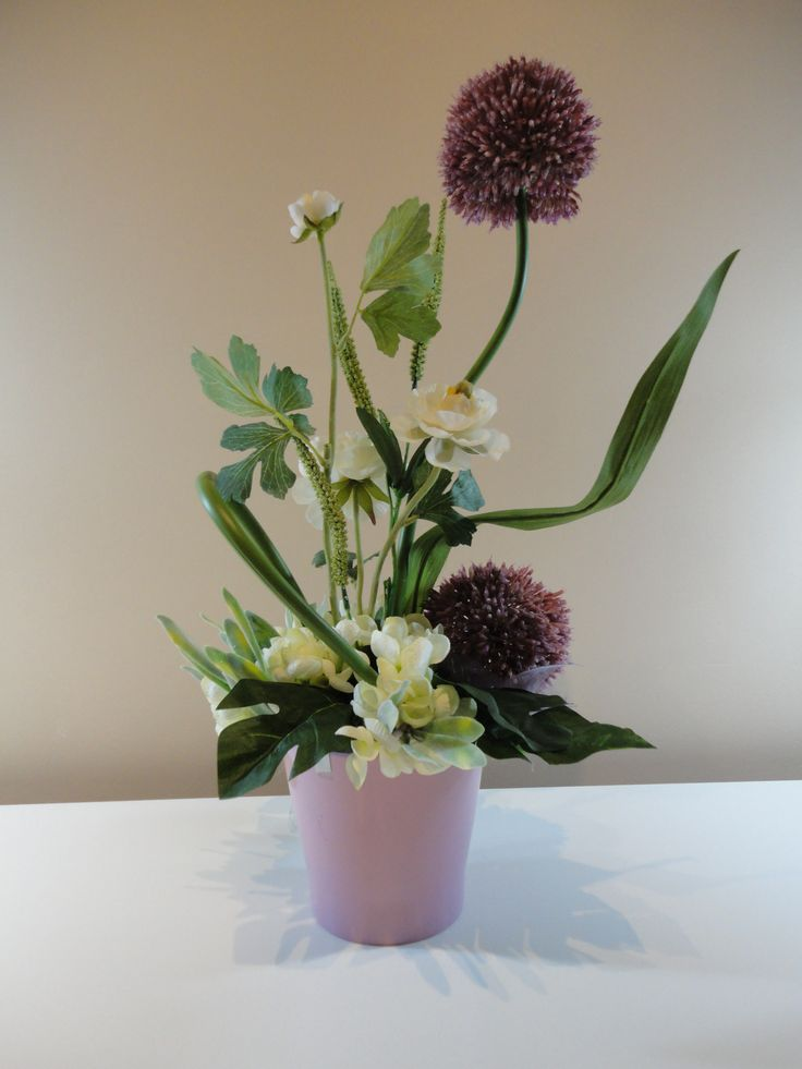 A gift that keeps on giving - our Lasting Flower Arrangement in Deep Lilac and White is a beautiful, amazingly realistic artificial arrangement which will certainly put a smile on the face of its lucky recipient, and will add a stylish decorative touch to their home for a lot longer than traditional fresh flowers.