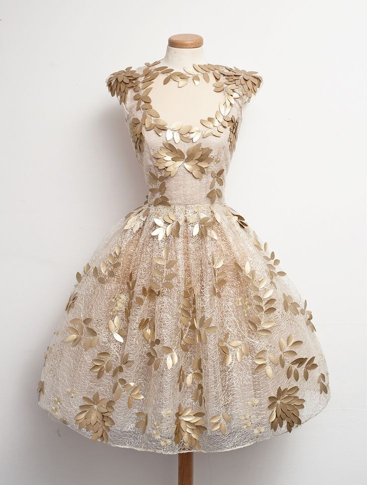 I love this so much! It reminds me of greek goddesses? (idk) It has a kind of tulle, layered look... but the gold leaf and the neckline make it look fabulous! I saw it on tumblr and all I know is that it's from here: www.chotronette.com