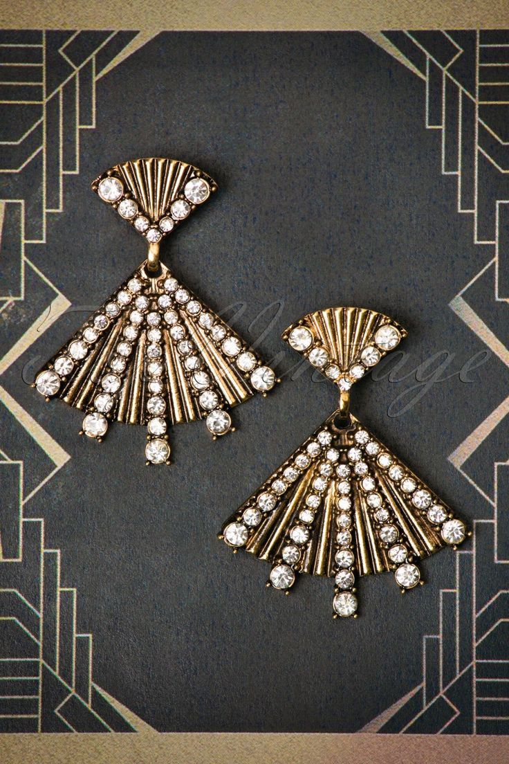 These30s Rosalie Fan Earrings are Art Decochic at its best! Found THE perfect party dress? These Art Deco beauties will add an extra portion glamour to your outfit! Made from gold toned metal, set with shiny rhinestones in different sizes. Só beautiful, everyone will need a fan to keep their heads cool after your amazing entrance ;-) Glamour, elegance and fabulousness to the max!   Gold toned metal Rhinestones