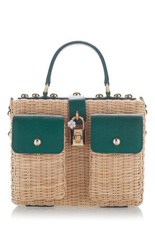 Dolce & Gabbana's shoulder bag is woven from rattan and trimmed with emerald textured-leather. Punctuated with stud embellishments, this structured style has two external pockets and opens to a polka-dot interior with enough space for the essentials. It's finished with a detachable shoulder strap and daisy-embellished lock.
