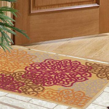 This door mat will look attractive in any home and looks really fabulous in a combination of purple and orange. This door mat is made of high quality nylon and has fetching floral patterns too. #DiwaliDecor #FabFurnish