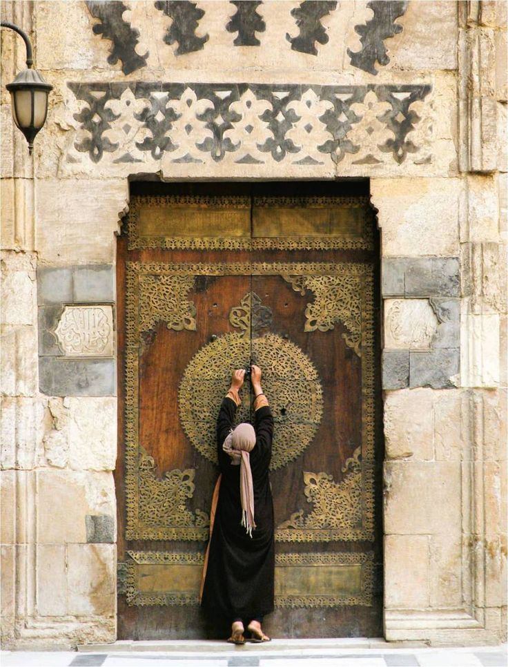 Egypt Attendant closes the doors to a side room inside the Madrasa of Sultan Barquq in Cairo Maya Dukmasova '12, a philosophy and religion major from Liverpool, N.Y. American University in Cairo, October 2010