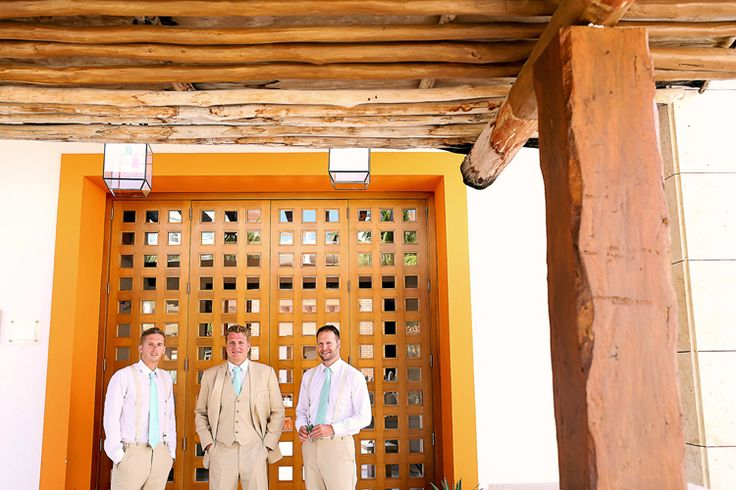 Groom and groomsman inspiration for a beach wedding: turquoise ties and khakis (This One Photography)