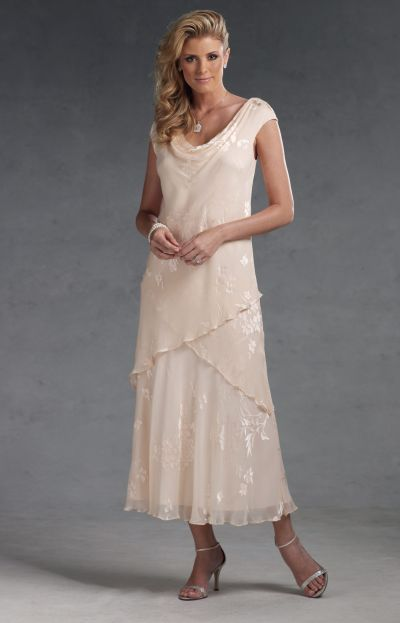 Silk burnout dress with cowl neckline and cap sleeves, bias-cut tea-length skirt with chevron overlay. Matching shawl included.