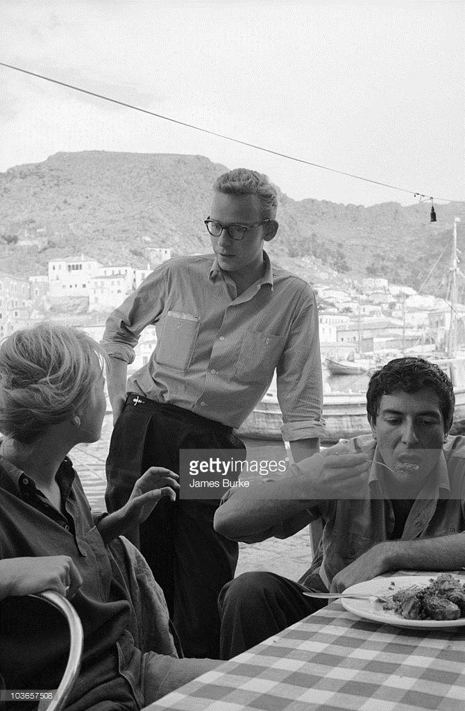 Leonard Cohen eating with Marianne Ihlen and her partner Norwegian novelist Axel Jensen, Hydra, Greece October 1960.