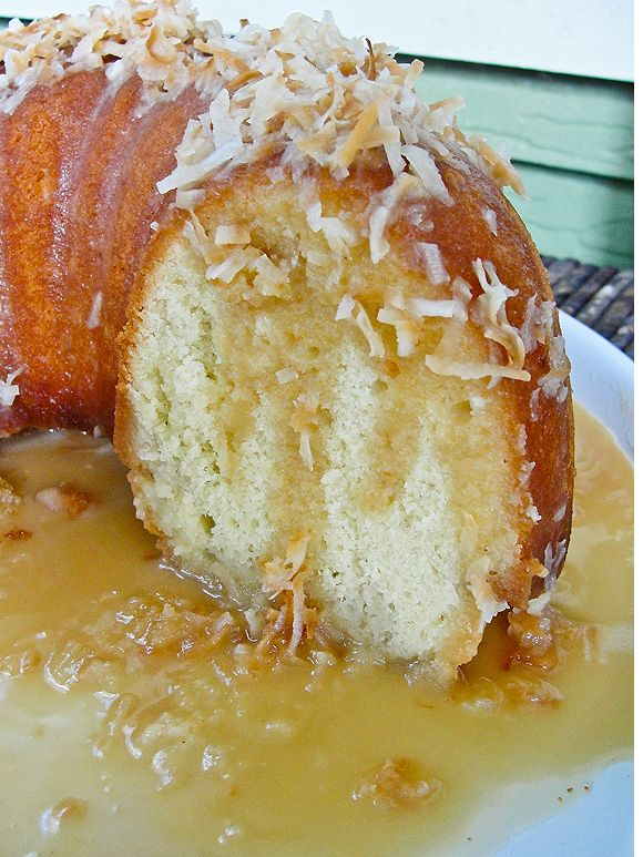Bahamian RumSoaked Coconut Cake:      Coconut Rum Syrup   ¾  c canned coconut milk    6 Tbsp sugar   ½ c dark rum     In a medium saucepan over medium heat, warm the coconut milk, and the sugar, stirring until the sugar dissolves.  It shouldn't come to a boil.  Remove the syrup from heat and add the dark rum.  Whisk everything together.  Set aside until the cake comes out of the oven.
