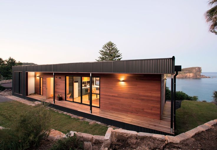 A prefab house designed by ArchiBlox on the northern beaches of Sydney sustains high winds and spray from the surf, so the firm wrapped the exterior in marine-grade Colorbond Ultra steel. Panels of Queensland blue gum, a native Australian hardwood, clad the street-side facade, which is protected from the harsh climate.