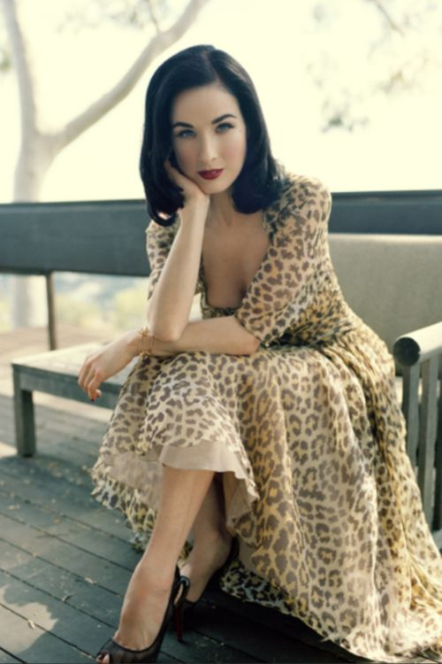 Dita von Teese in retro dress / animal print.