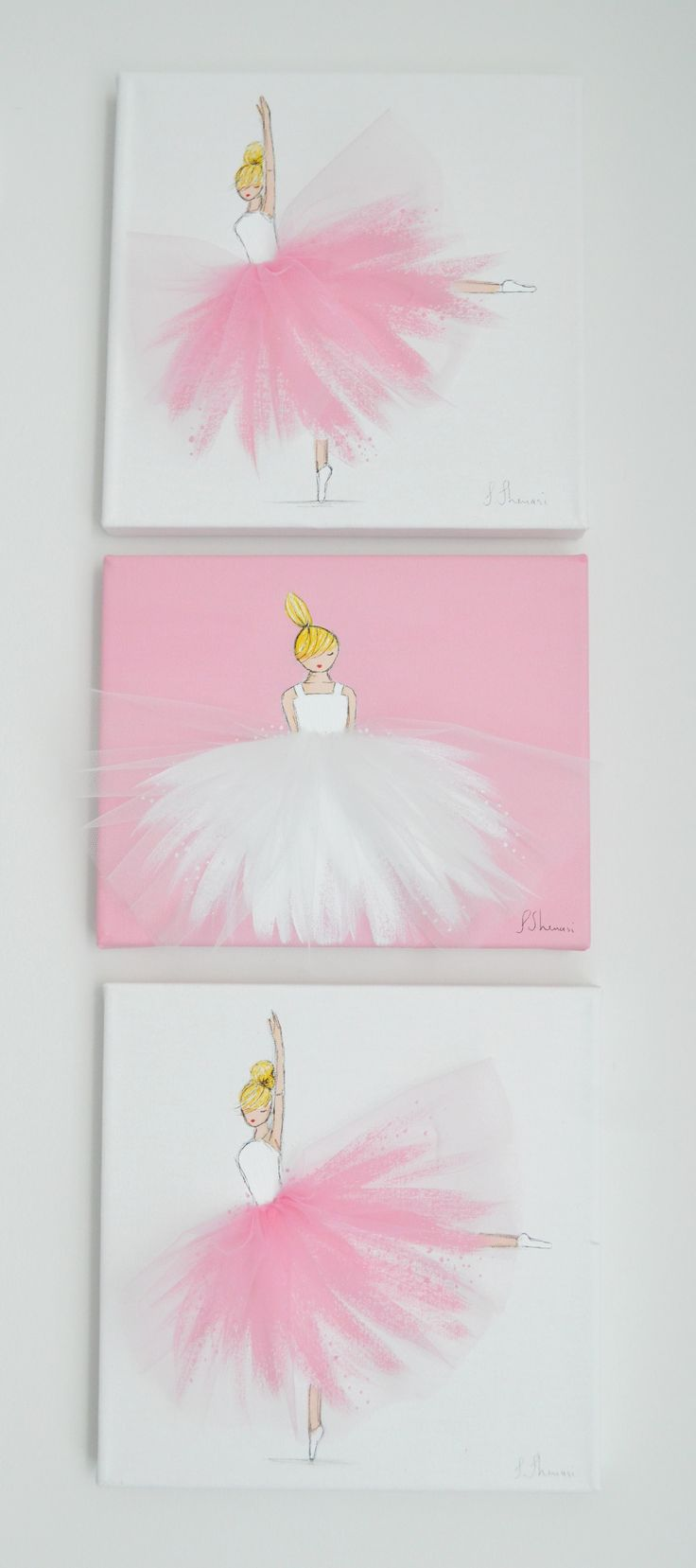 I think I'll use this idea and ad my own tulle to girls pictures for the room, so cute!