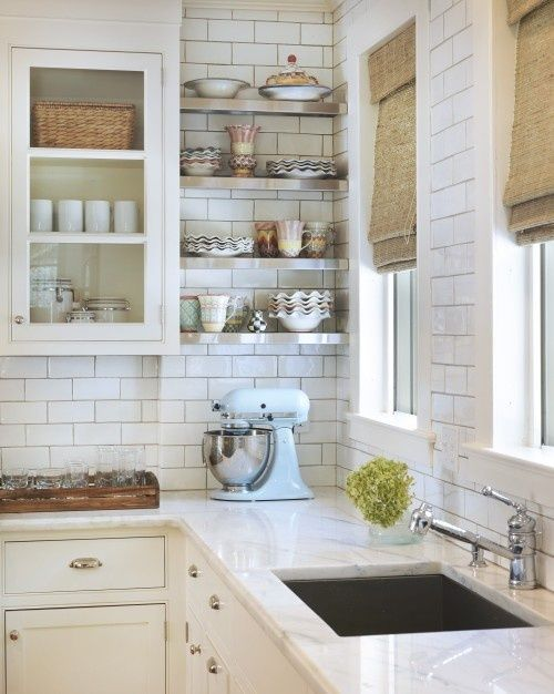 white & bright kitchen with open shelving, subway tiles and marble countertop