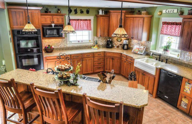 Quarter Sawn Oak Cabinets In Varying Heights Create A Craftsman Inspired Kitchen Design Home