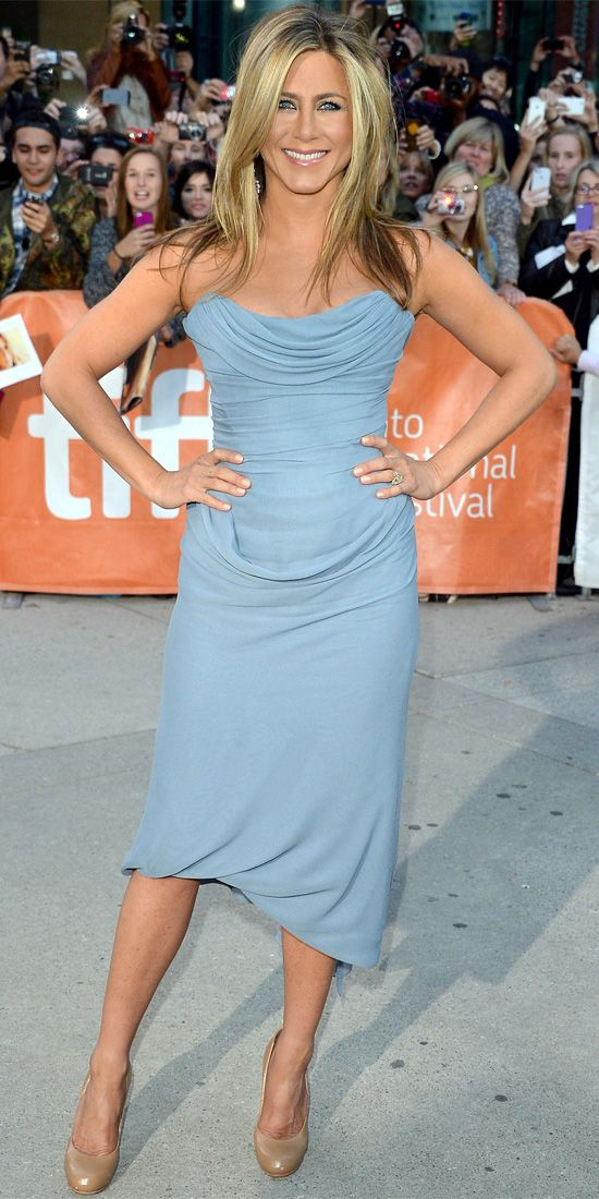 Jennifer Aniston - Look of the Day - InStyle \\ Aniston opted for a sky-blue corseted silk georgette Vivienne Westwood Couture dress at the premiere of Life of Crime at TIFF, pairing her look with nude pumps.