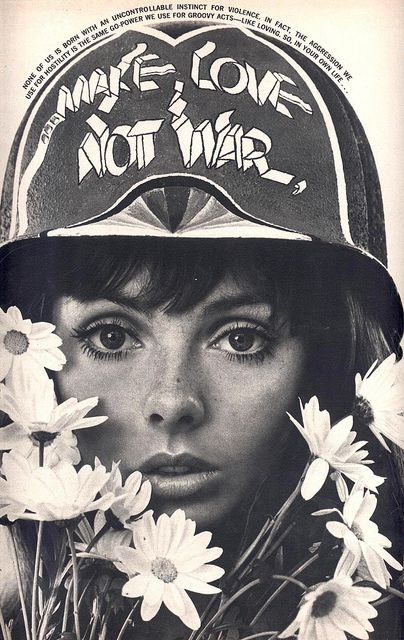 """Make love not war --> Make art not war. Put crayons on an ammo belt, arm her with a paintball gun, covered in painty """"wounds"""", sitting on a step like a BAMF."""