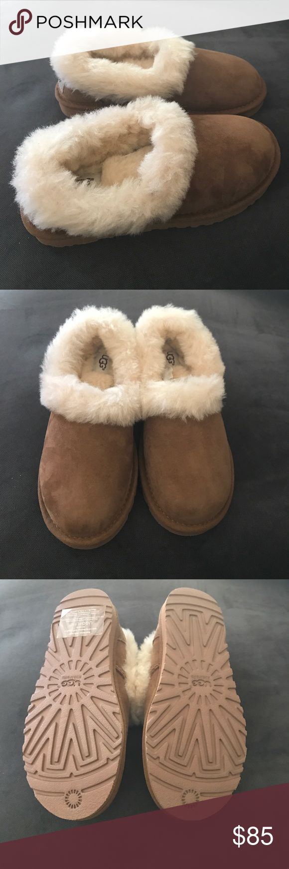"UGGNita Shearling Slipper UGG suede slipper. Bleached, dyed lamb shearling (Australia, UK, or USA) fur lining and trim. UGGpure™ 100% wool sock lining. 1"" flat heel. Round toe. Logo patch at backstay. EVA molded rubber outsole. ""Nita"" is imported. Brand new in a box but no lead on the box UGG Shoes Slippers"
