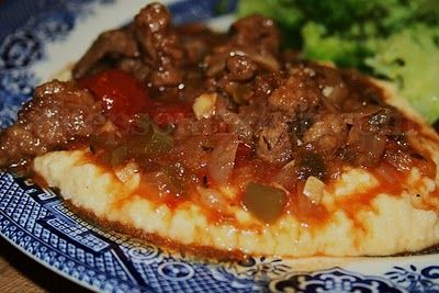Grillades and Grits a dish found on the menu at debutante balls and definitely a staple at Mardi Gras, is a dish of smothered beef, slow simmered in a roux and tomato base.  Made with just about any kind of beef, and sometimes even with pork or veal, I prefer to use inexpensive round steak.