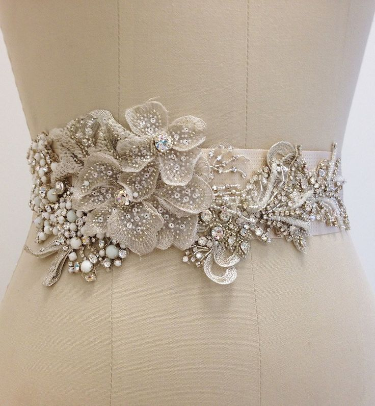 Erin Cole Bridal Belts & Sashes. Couture, refreshing designs. Beaded floral motif with heavily beaded appliques, clusters of crystals and white opaque beads