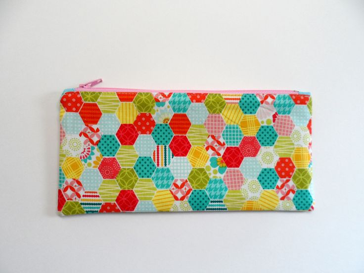 Great size zipper pouch for use as a pencil case, travel cosmetic bag, jewellery, or for organizing items or small toys in a diaper bag. The perfect small, useful gift. Approximate size: H4.25xW8.75ins