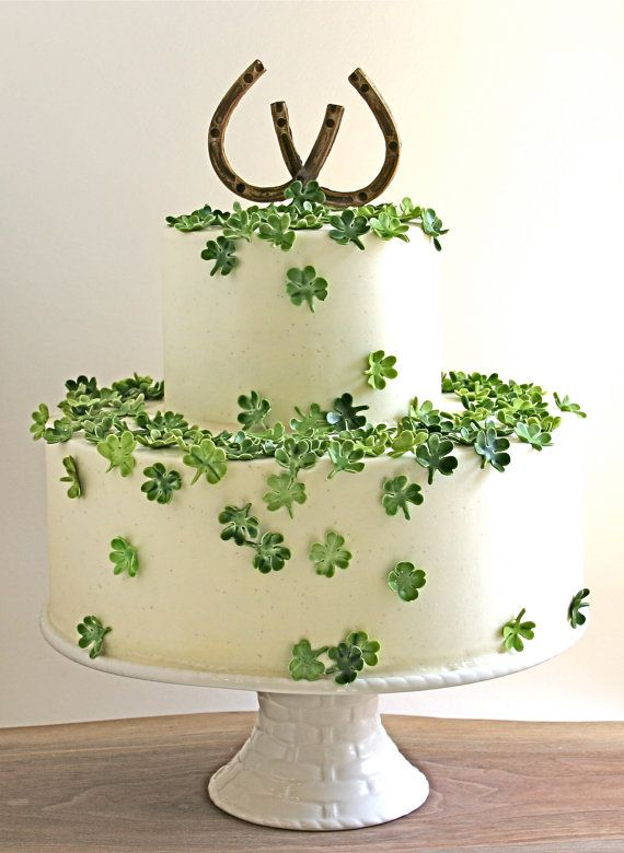 A cake decorated with candy four-leaf clovers ensures lots of luck for the happy couple.