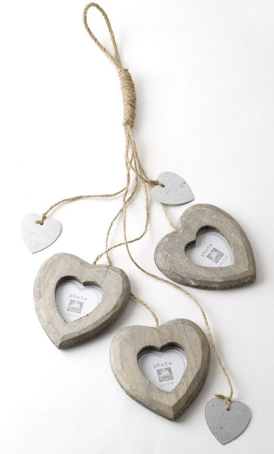 "3 Hanging Heart Photo Frame 3 shabby chic hanging heart photo frames on jute string with metal heart cut outs.  Size - Photo size: 3"" x 3"""