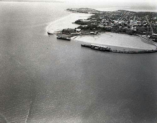 Aerial photograph of Stokes Hill Wharf, Darwin, c. 1961. The marshy area in the foreground has been reclaimed to create the Darwin Waterfront recreational area.