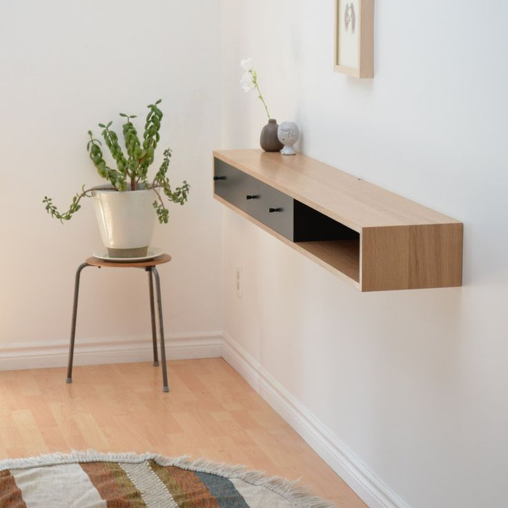 neat idea to sit under a wall mounted TV. Pretty sure we could make this and fill it with ikea wicker baskets.