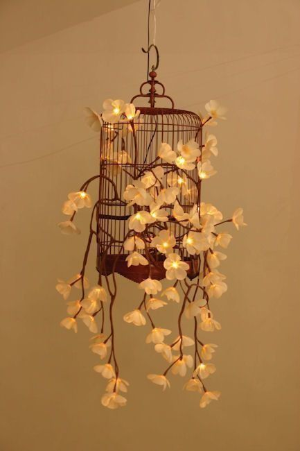 This is a great idea for people who want a softer, more floral look for their string lights. Try winding them through a birdcage for an even more charming effect.