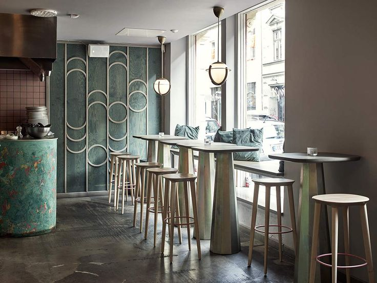 Audrey clear lacquered wood bar stools at restaurant Pompom