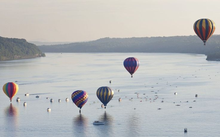July 2014: Hot air balloons take off over the Hudson River in Poughkeepsie, New YorkPicture: ZUMA/REX