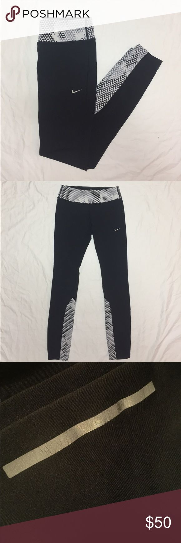 Nike Epic Running Tights Full length running tights with a cute geometric pattern on waistband and lower leg. Worn but in good condition. Slight cracking in reflective strip. Nike Pants Leggings