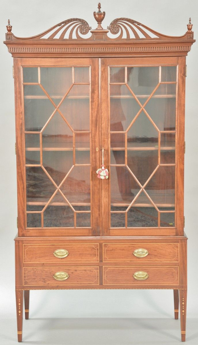 Margolis mahogany china cabinet in two parts, upper portion having pierce carved top over two glazed doors on lower portion with two drawers over two drawers all set on square tapered legs with line, diamond, and dot inlays ~ Realized Price $3000.00  #nadeausauction