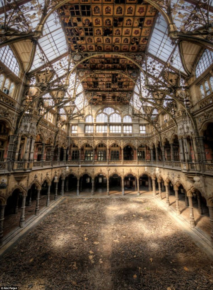 Grand: The photographer captured the soaring glass ceiling and detailed brickwork of this vast abandoned building