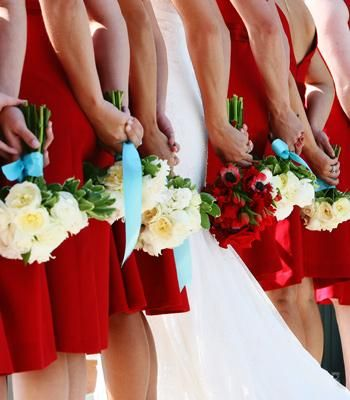 Red bridesmaid dresses- This is totally what I was kind of thinking about... red bouquet for the bride, white for the bridesmaids... hmm... maybe?