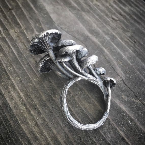 Sterling silver mushrooms grow from a ring with wood bark texture. I NEED THIS IN MY LIFE!!