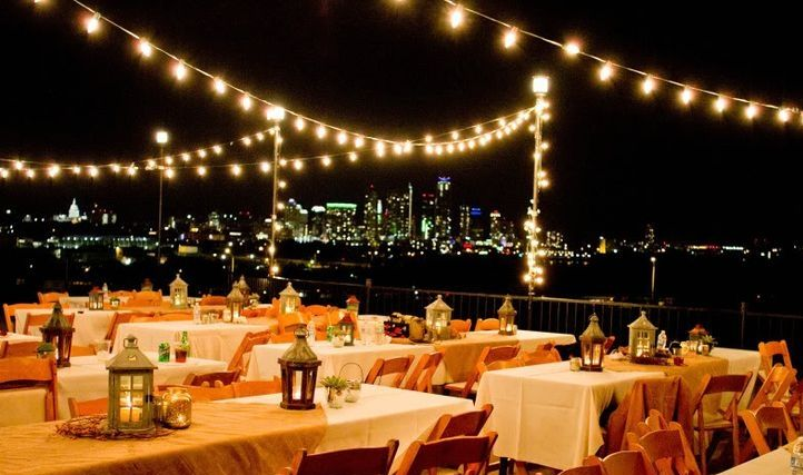 Zilker Patio At Night With String Lights And Dinner Setup