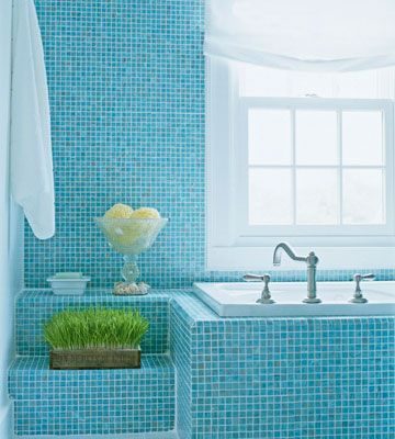 Relaxing Cerulean Blue  A dramatic sweep of floor-to-ceiling blue-glass mosaic tiles outfits this sea-themed bathroom and establishes the relaxing color palette.