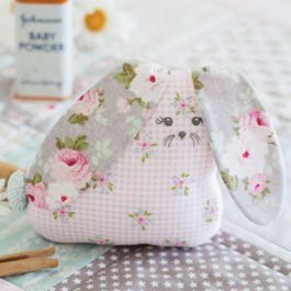 Make a sweet gift for a new baby with this patchwork and appliqué mini quilt, embroidered bunny softie and patchwork ball baby trio pattern from Cheryl Goss.